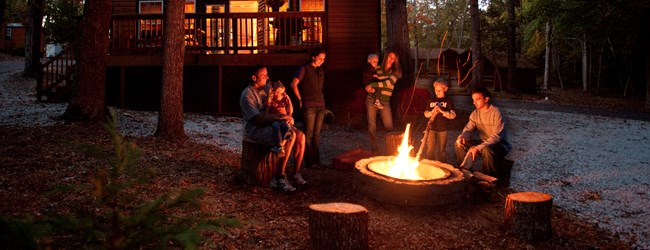Cozy around a campfire at your Deluxe Cabin!