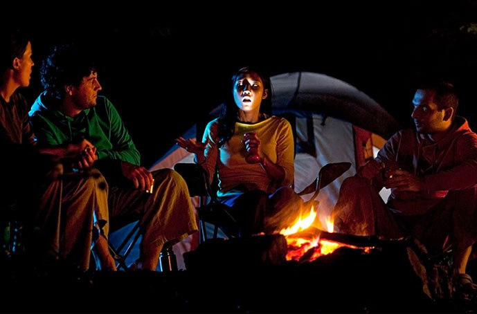 Camping in the woods at night Horror tis The Season For Stories That Go Bump In The Night Try These Notsoscary Stories To Spook Your Kids This Halloween Koa Campgrounds 11 Kidfriendly Spooky Campfire Stories Koa Camping Blog