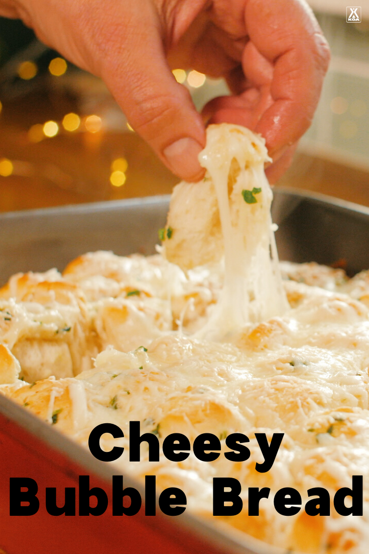 Oh so cheesy and totally delicious, this easy recipe for cheesy bubble bread is sure to be a hit at your next party or family gathering.
