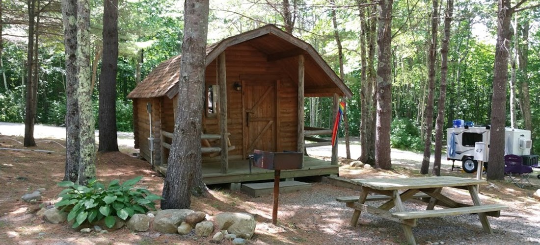 Rustic Camping Cabin (w/ Bathroom)  Come escape to the woods and sit on the swing and enjoy the view. Great cabin to spend time with the family