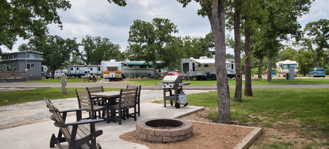 Deluxe Patio Site come with outdoor seating, fire pit, and gas grill.
