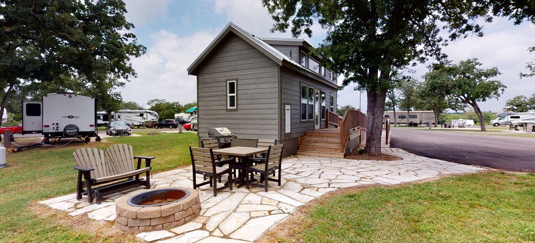 ADA Deluxe Cabin come complete with a fire pit and outdoor seating.