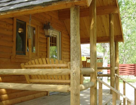 Our cottages, also called Deluxe cabins, have indoor plumbing. No need to run to the bath house in the dark! Some of our deluxe cabins sleep as many as six people. Linen packages can be rented: $20/two people, $10/one person.