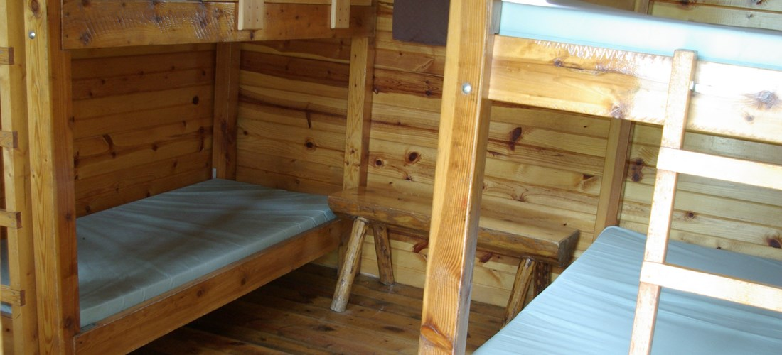 Camping Cabin sleeps 6 shows double bed bunks