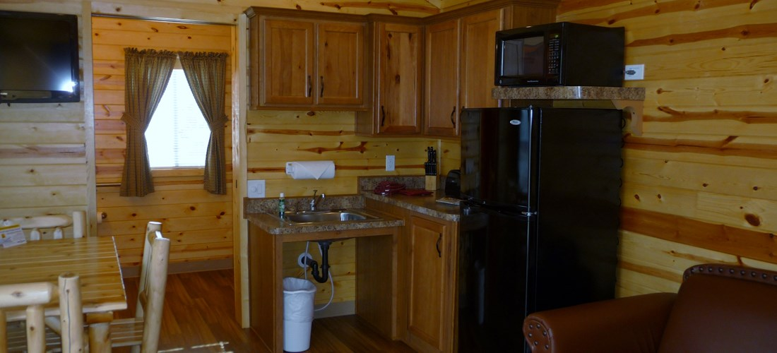 The kitchen and living room have many amenities to make your stay comfortable.