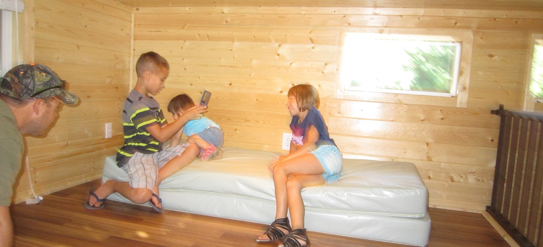 The sleeping loft is perfect for kids.