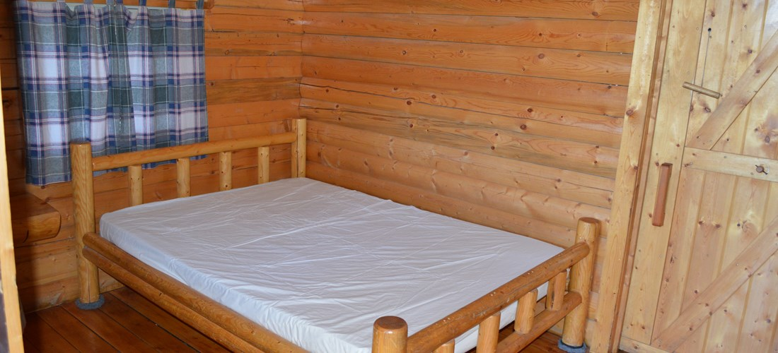 Full size bed in main room
