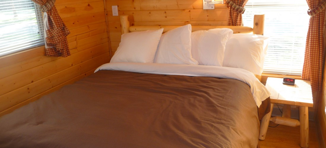Cabin has a private bedroom with queen bed.