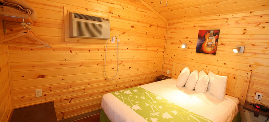 This cabin has a private bedroom with queen bed.