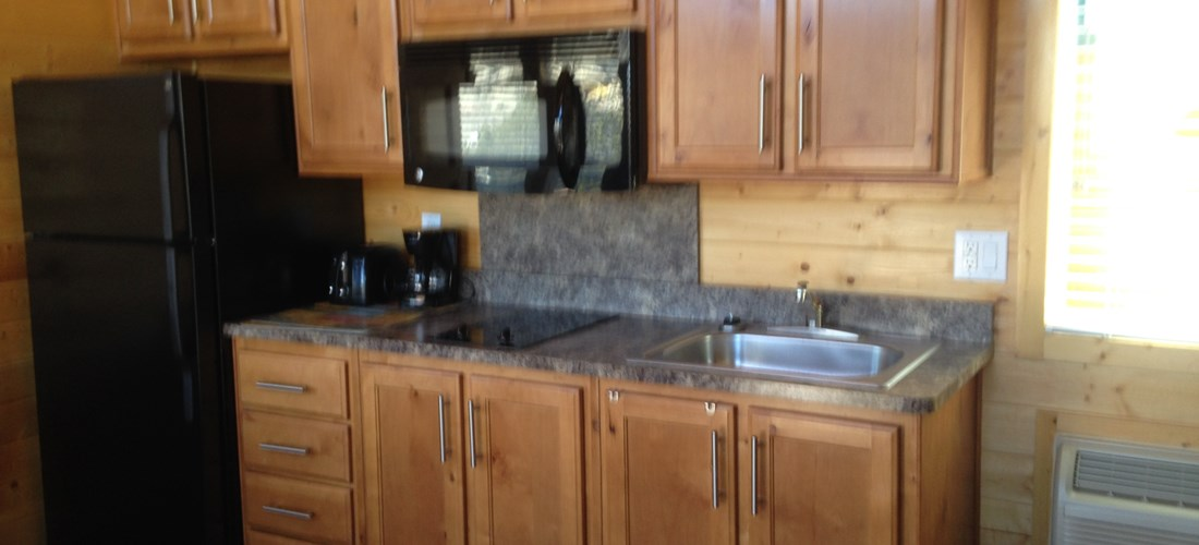 One of Our Deluxe 2 Room Lodge Cabin's Full Kitchen Kitchen
