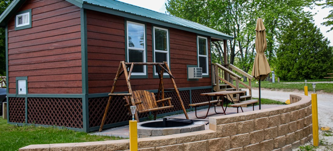 Studio lodge with large brick patio. Enjoy your campfire and watch your barbecue  sizzle from the comfort of a patio swing!