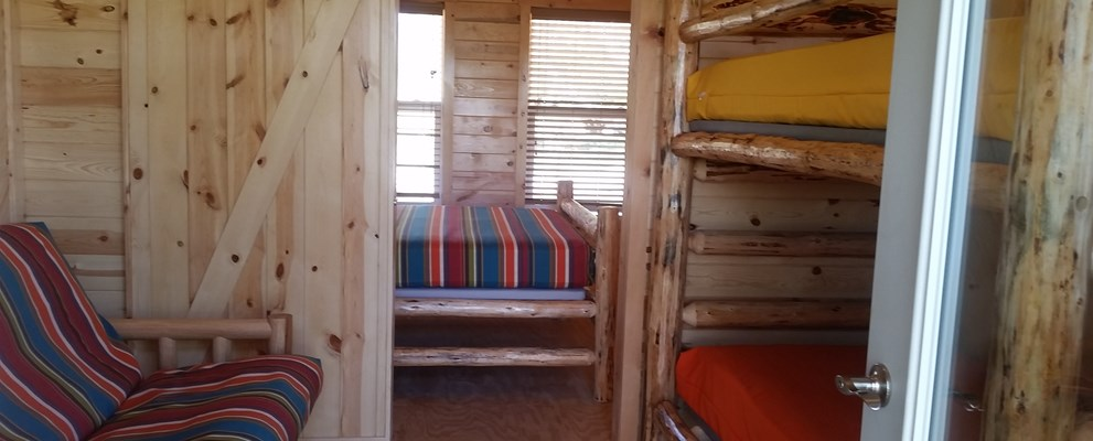 2 Room Camping Cabin, sleeps 6! Just bring your sleeping bags.