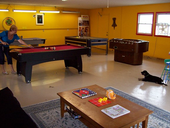 Playroom with pool, ping pong, foosball.