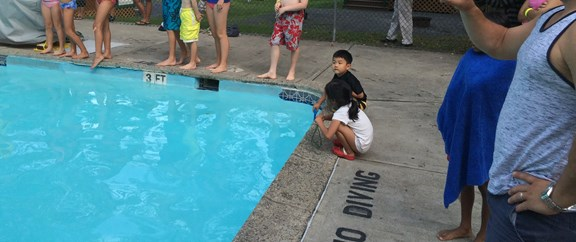 Kids were warned of bitter cold water after 800lbs of ice was dumped into the normally heated pool.