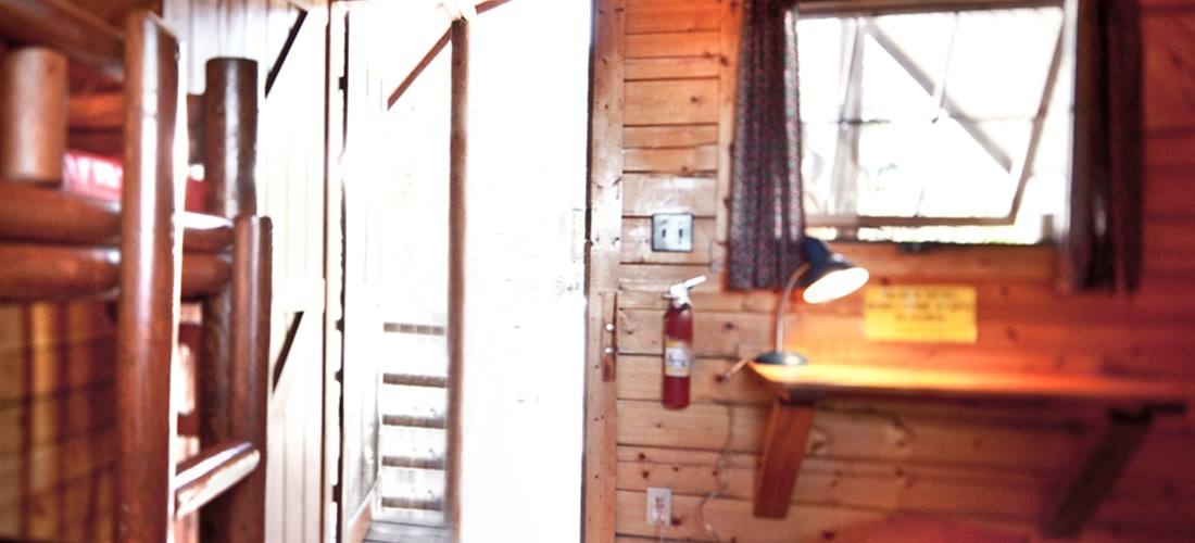 Rustic 4-person cabin interior - photo by Kampgrounds of America, Inc.