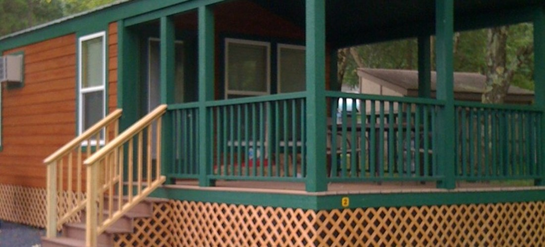 Lovely covered porch on deluxe cabins