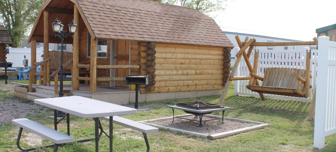 Our one room camping cabin comes with a double bed, a set of bunks, heat, a/c, cable tv, picnic table, front porch seating and gas grill. Enjoy the rabbits and the occasional Jackalope. Restrooms located close by along with the pool and playground.
