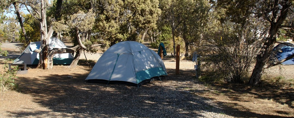Nestled in the pinion and juniper trees, our tent sites are available with No-Hookups and Water/Electric Hookups! Each have mulch pads to set up your tent on.