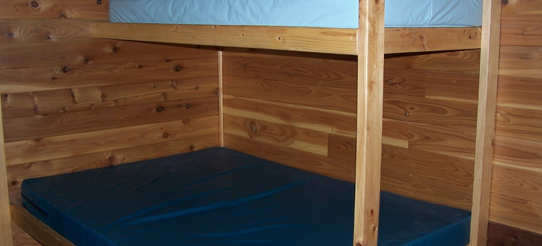 Double bed with upper bunk