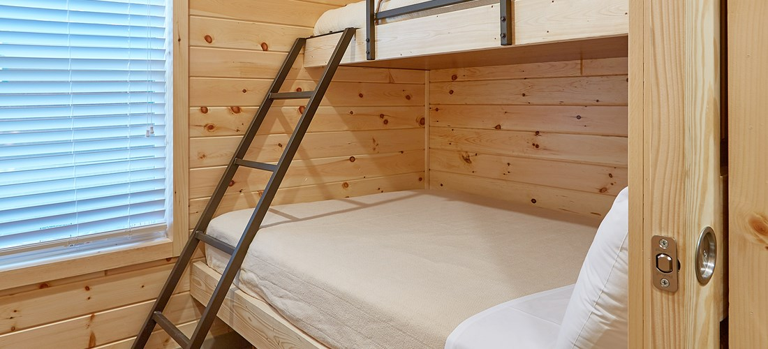 Premium Cottage bedroom with twin over full bunk.