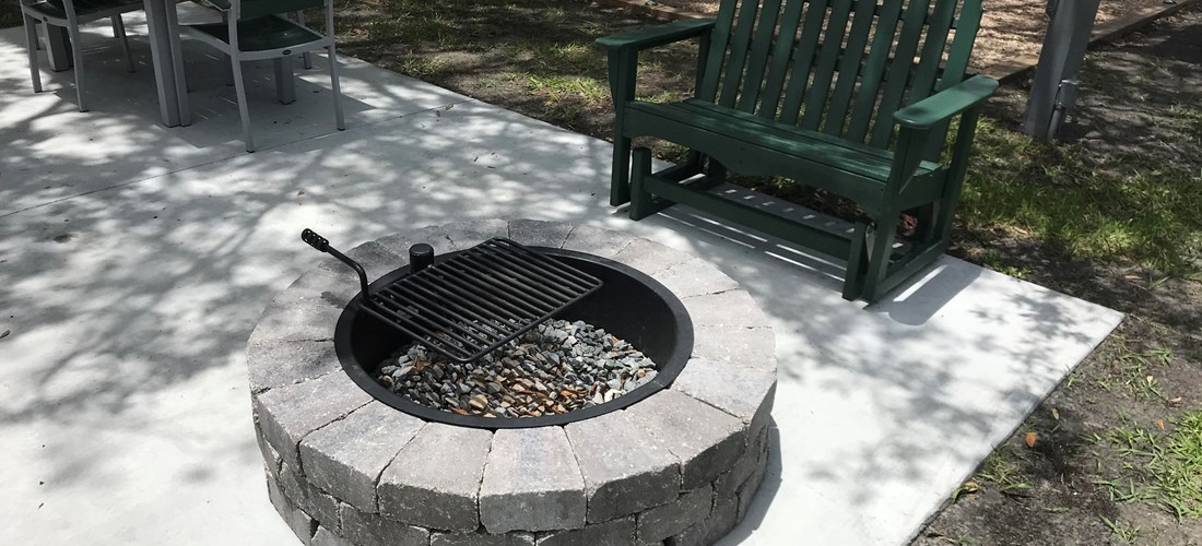 Tent Fire pit w/ cooking grate, glider and patio furniture
