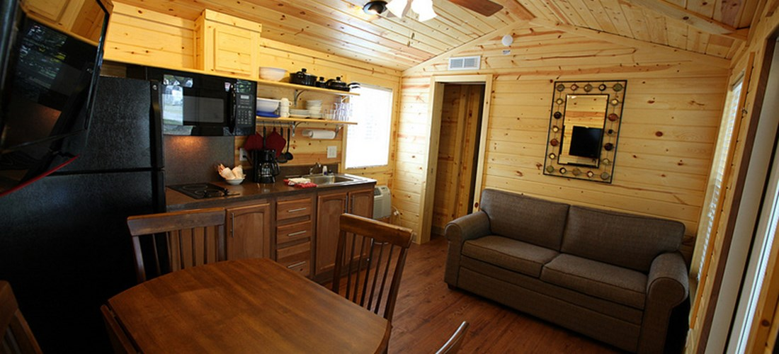Our cabins even have televisions and the living and kitchen are are well appointed.