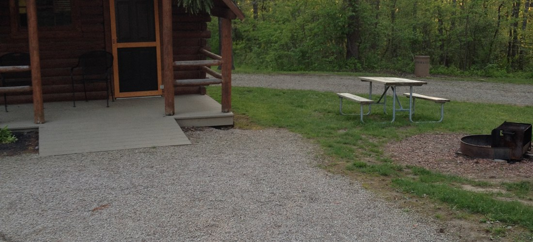 Couples Camp Cabin - Enjoy a Campfire or Relax on the Covered Porch