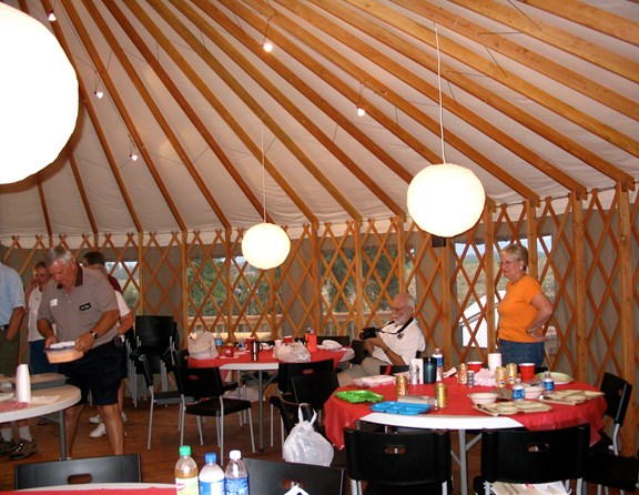 Inside our special round Yurt gathering area we have tables and chairs for up to 50 people or more, for our special group activities and events. The space is also used for showing movies on Movie Night during summer weekends. You'll be sure to enjoy our big round tent!
