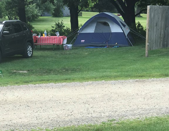 Tent sites now have wood fence dividers for more privacy.