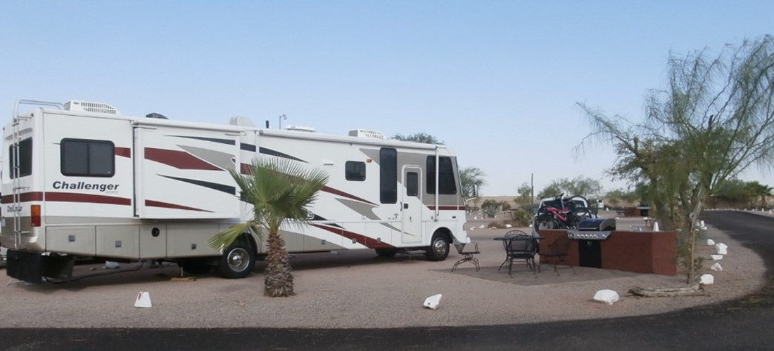 Pull Thru, 50/30 Amps, Full Hookups, Deluxe Patio Site Deluxe patio beautifully landscaped, specialty patio furniture, gas barbecue and sink. Best view of the Superstitions. Limited number available.