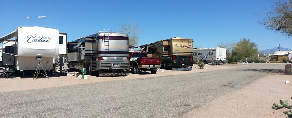 Pull Thru, 50/30 Amps, Full Hookups Enjoy the beauty of the Superstition Mountains from your own campsite. These large pull-thru sites are perfect for the overnight big rig traveler. Golf, shopping and sightseeing are nearby.