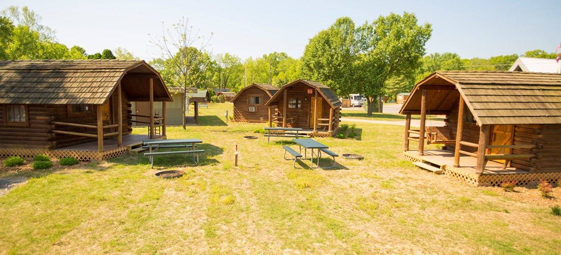 Our rustic cabins are conveniently located to the bath-house and come with charcoal grills, fire rings and a picnic table.
