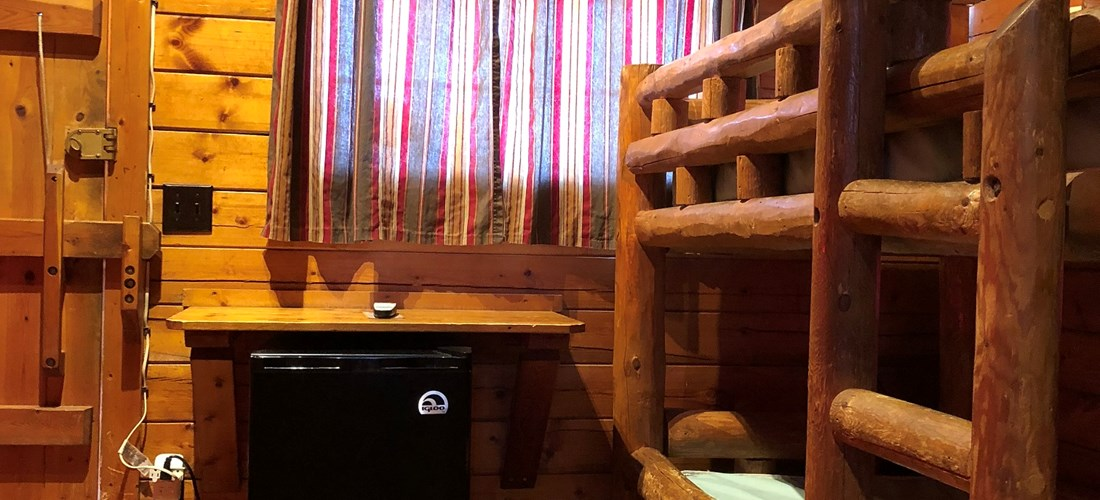The 2 bedroom cabins have 2 sets of bunk beds in the front room as well as cable TV and a mini-fridge.