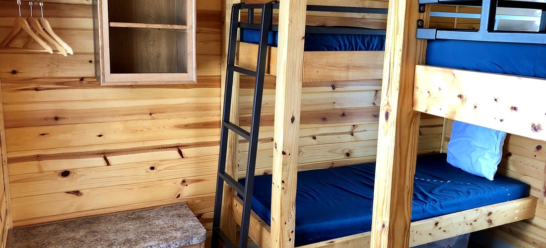 2 sets of bunks means everyone has their own bed and space.