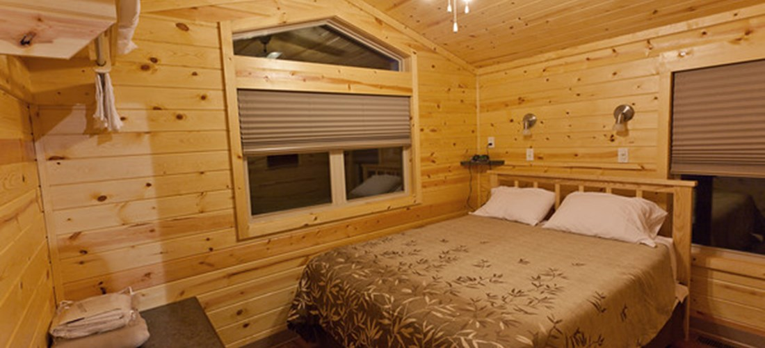 .Master Bedroom in Deluxe Cabin Floor Plan 28 and 33