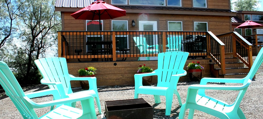 Deluxe Cabin - porch with grill, patio dining area, outdoor seating and firepit.