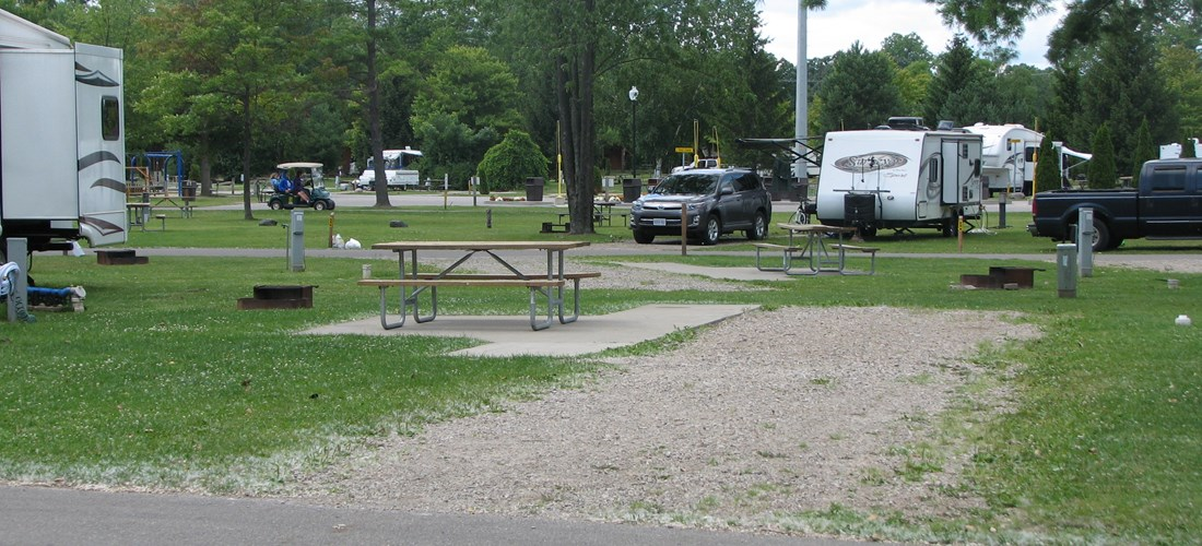 Deluxe site. Park on gravel with a cement patio.