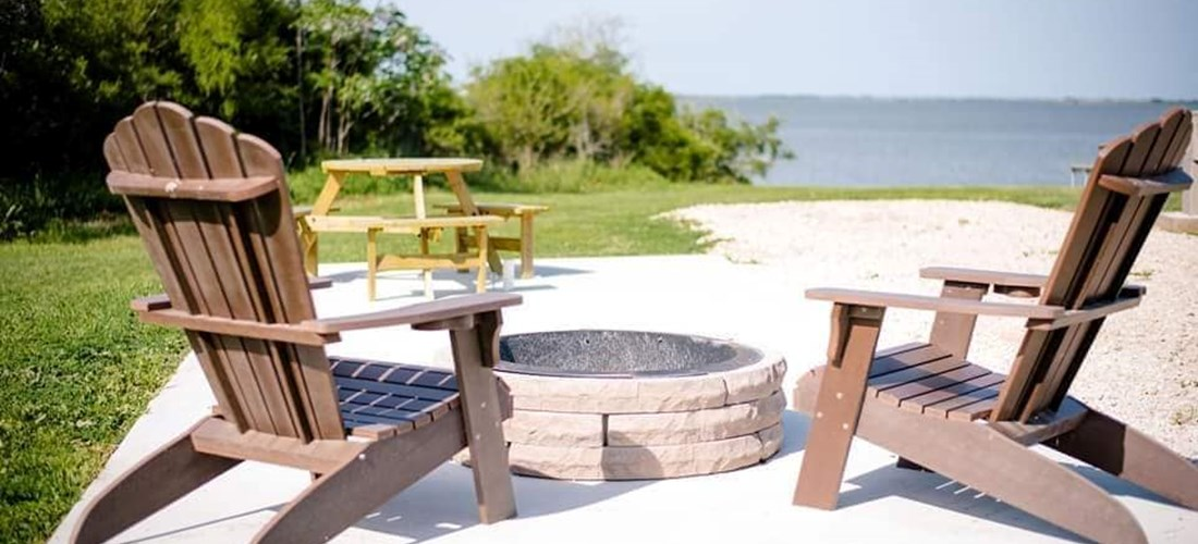 Waterfront Patio Site, with nice seating and a fire pit!