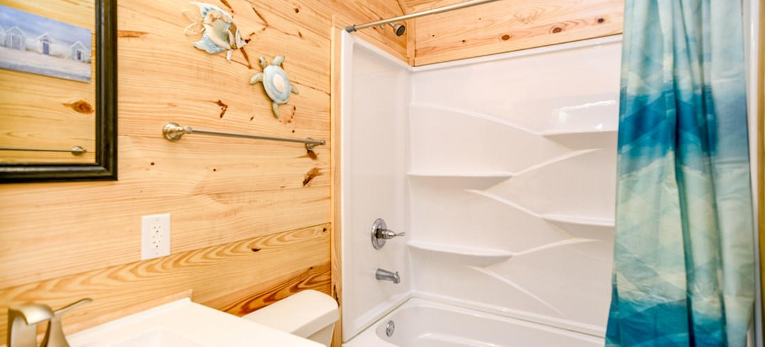 Our one bedroom cabin offers a full restroom.