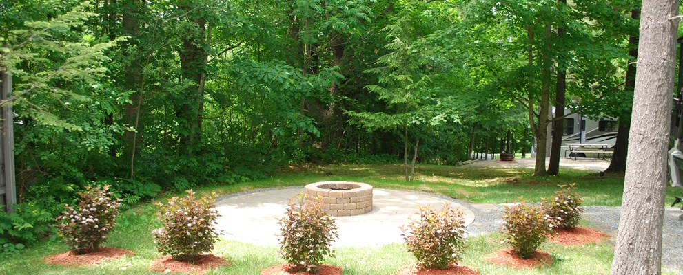 Beautiful view from your front window! Circular pavered patio with deluxe stone firepit.