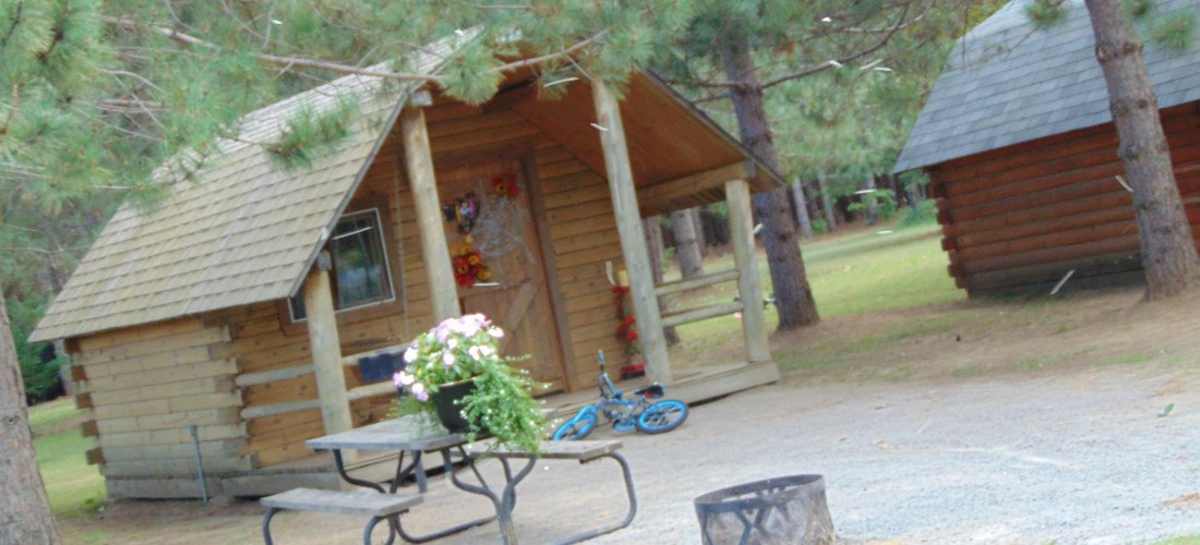 Cabins sleep 4 comfortably, with a mini-fridge, power, fire-pit and picnic table. Beautifully shaded and naturally cool.