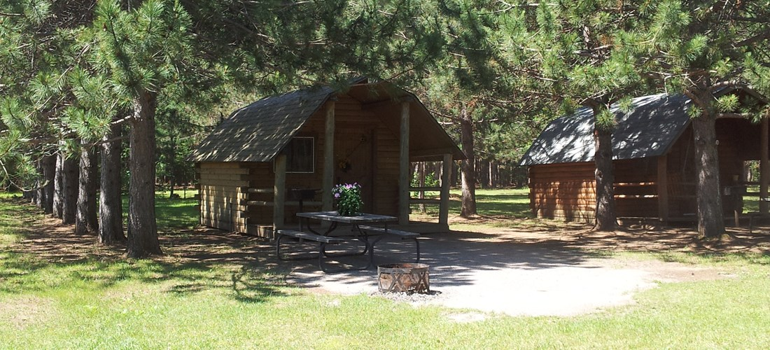 Beautiful cabin set in the pines with view of the lake. Sleeps 4, has power and a mini-fridge included.