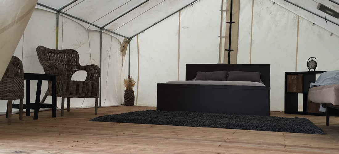 Large Tent with Furnished Bed and seating. Great view of the Bridge