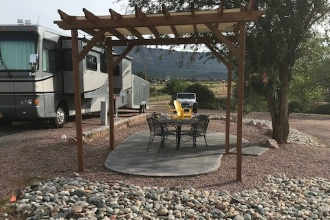 Deluxe Patio with Pergola and Concrete Pad