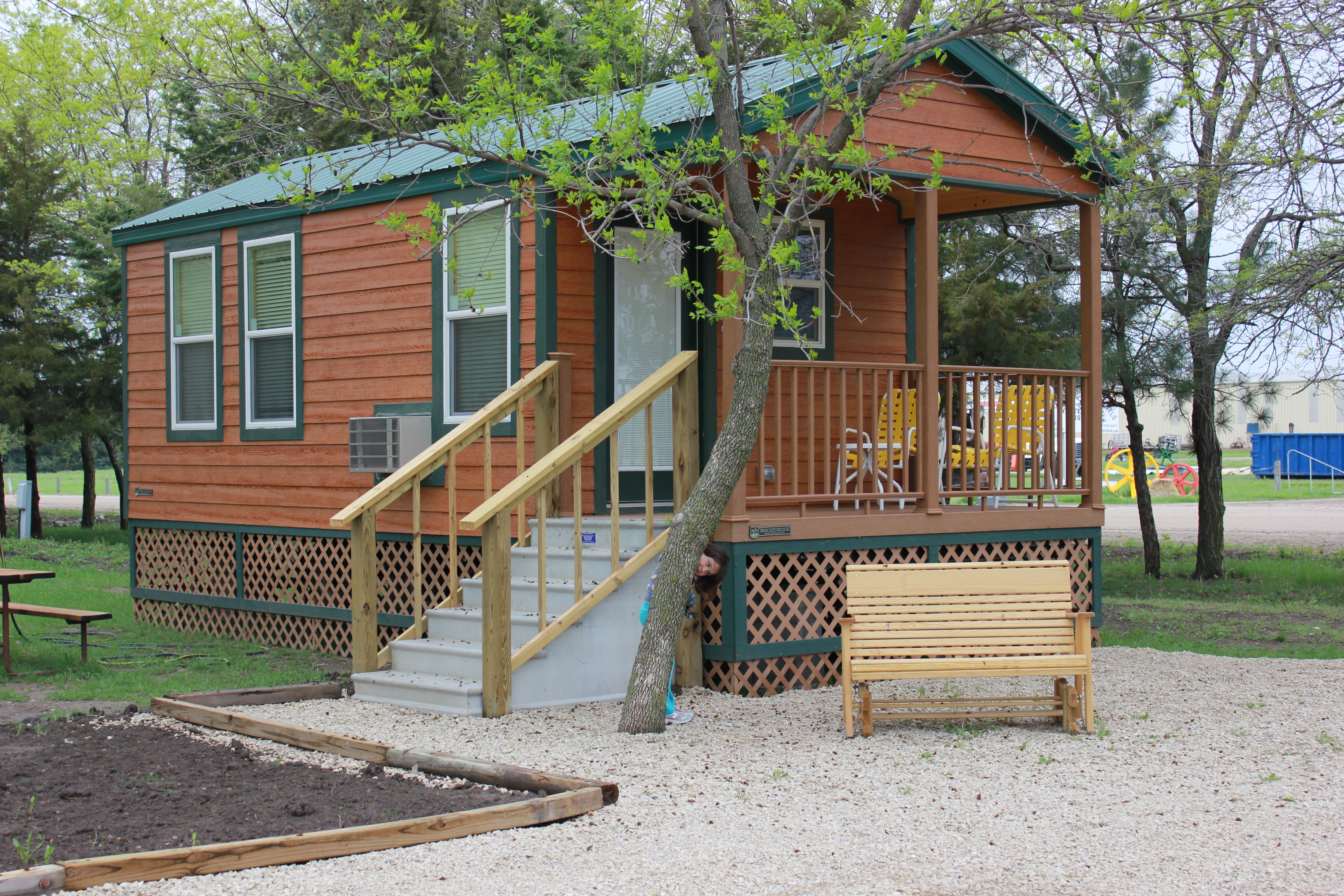 to document cabins in front acorns official county geary a cabin rentals log cvb documentid rv resort entrance campground kansas