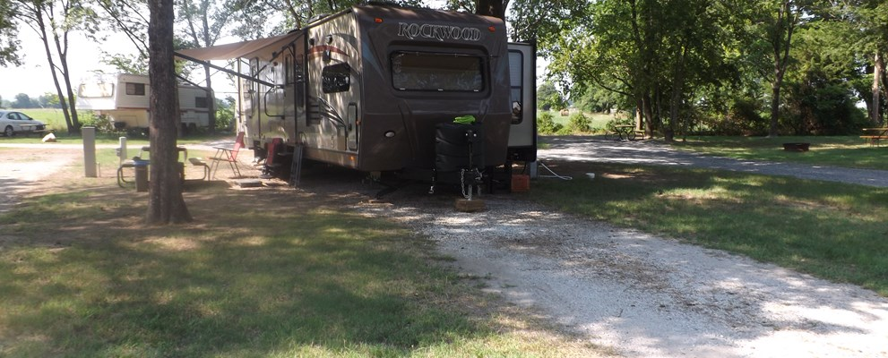 Long, pull-thru site with full hookups and large, mature, shade trees that are kept trimmed, even for the largest RVs.