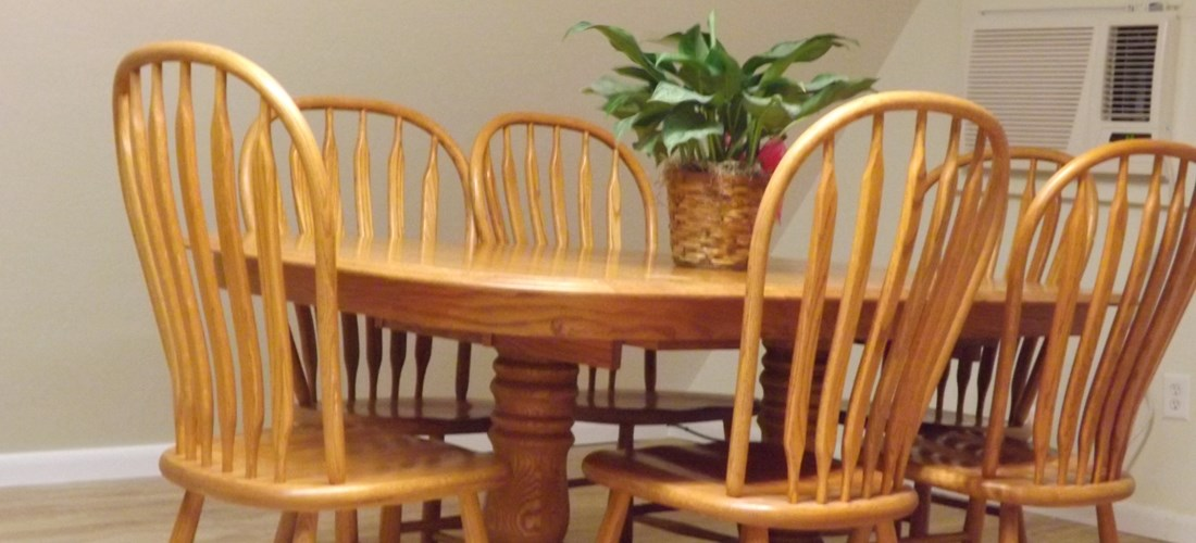 "Large dining room with solid oak table and chairs; expands to 102""!"