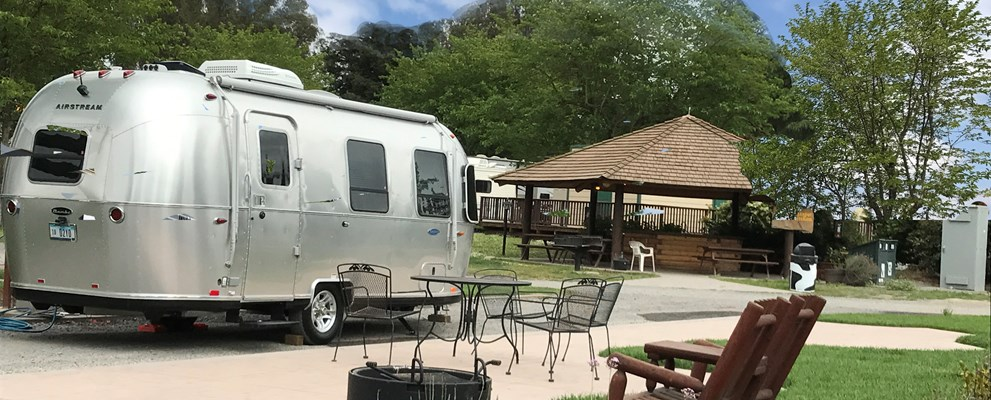50amp pull thru patio sites have beautiful stamped concrete patio, furniture, firepit, free wifi and concierge septic pumping.  These huge pull thru sites are campers favorites and sell out quick.