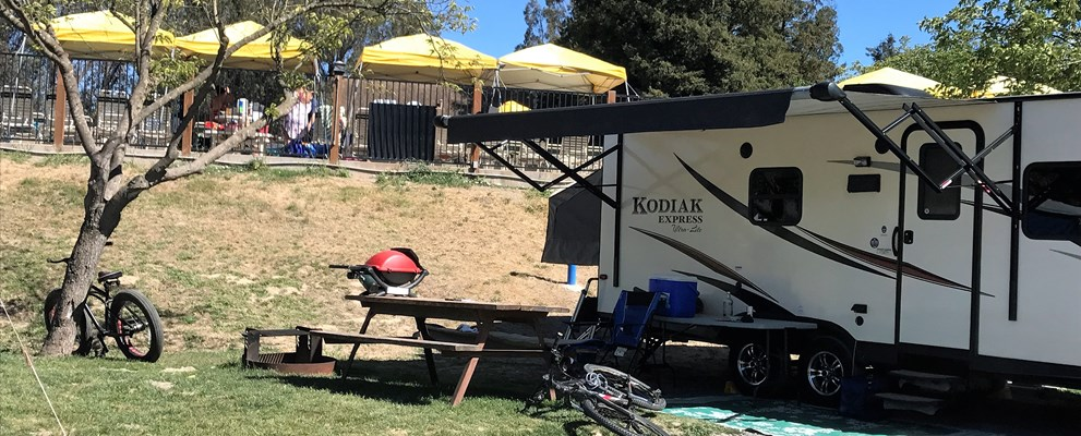 Brand new 50 amp back in RV sites in the Valley View area feature Direct TV cable, picnic table , fire ring and daily concierge septic pumping.  The camping kitchen and bathrooms and showers are close by.
