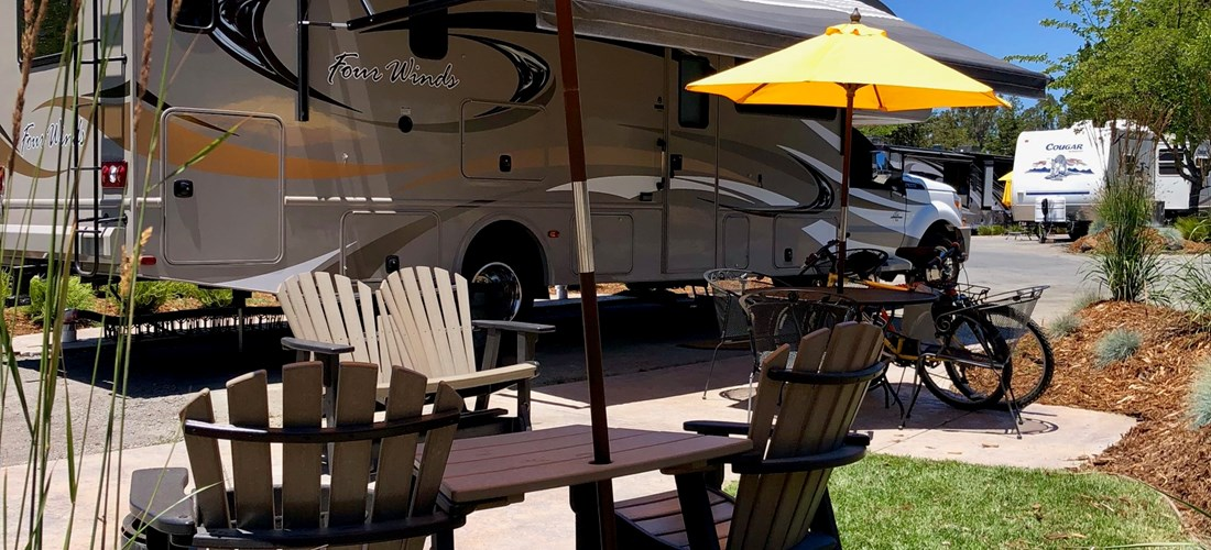 A patio end site with furniture, fire pit, 50 amp and room to relax and unwind.